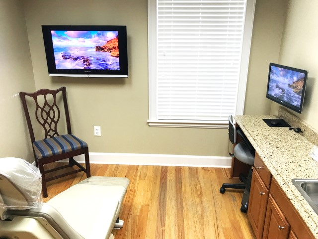 Patient room with computer and mounted television