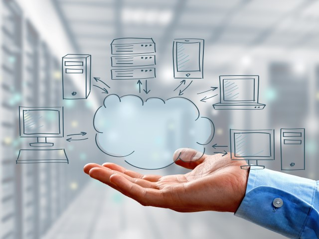 Graphic of hand holding cloud diagram in a server room